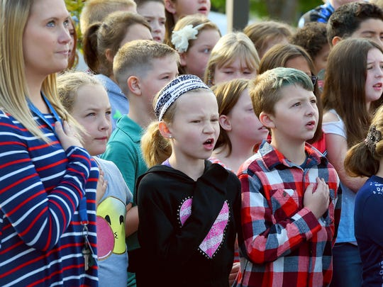 "Fourth-graders Elizabeth Sushko and Josh Robertson sing the national anthem with their fellow students and others gathered. Students at Clymore Elementary invited first responders, active military and veterans to join them and students from Fort Defiance High School and Stewart Middle to honor them for the school's annual ""National Anthem Day"" on Sept. 11, 2017."
