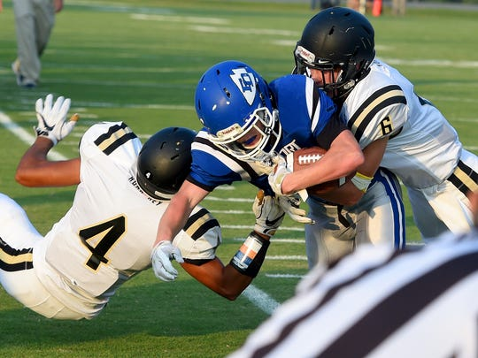 Fort Defiance's Matthew Wonderley, center, is currently third in the Valley District in rushing.