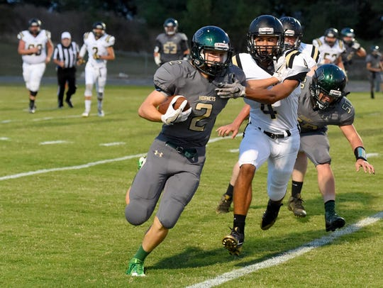Carrying the football, Wilson Memorial's Colton Tyree
