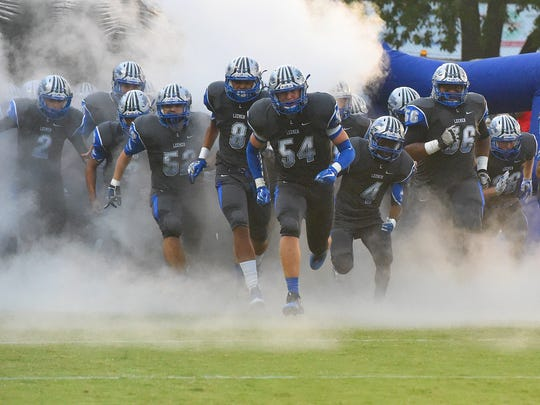 The players of Robert E. Lee High School take the field during a football game played in Staunton on Friday, Sept. 15, 2017.