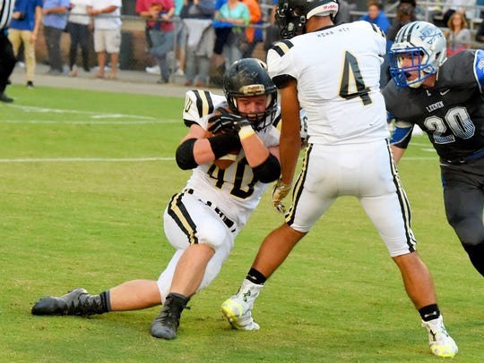 Buffalo Gap's Ryan Wilcher goes down with the ball