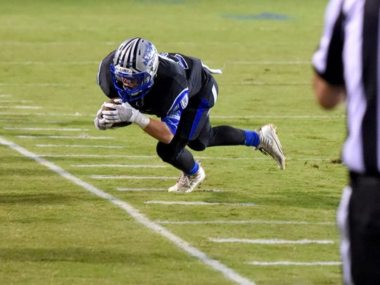 Robert E. Lee's Matthew Larson dives for out of bounds after catching the pass for a first down while moving the ball down the field during the final minutes of a football game played in Staunton on Friday, Sept. 15, 2017.