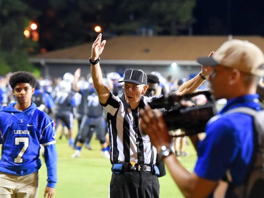 "Game official Wayne ""Slim"" Hite  signals a touchdown for Robert E. Lee  during a game played in Staunton on Friday, Sept. 15, 2017.The game marked Hite's last planned varsity football game where he would be calling plays at."