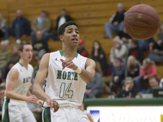 Tyrese Haliburton (14) of Oshkosh North throws a pass in a Fox Valley Association conference game against Appleton East on Tuesday, December 22, 2015.