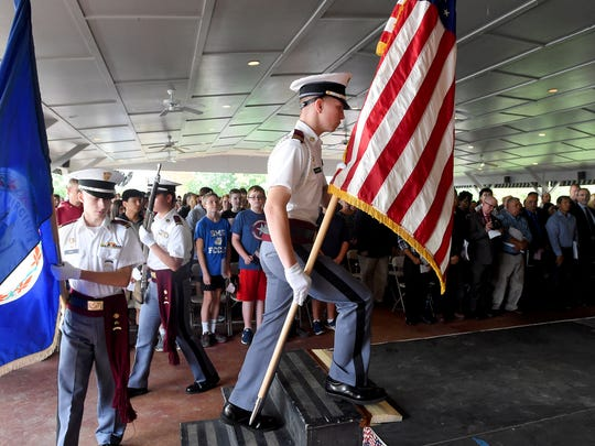 The Fishburne Military School color guard posts the colors at the start of the ceremony. America got more than 70 new citizens at a naturalization ceremony held at the Frontier Culture Museum on Tuesday, Sept. 19, 2017.