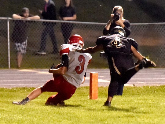 Riverheads' Drew Bond takes the ball into the end zone
