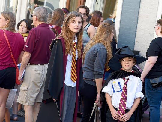 Allison White of Arlington, dressed as Hermione Granger, stands with her 11-year-old nephew, Logan Lloyd, of Stuarts Draft during the Queen City Mischief & Magic festival in downtown Staunton on Saturday, Sept. 23, 2017. The three-day festival celebrating Harry Potter ends Sunday, Sept. 24, 2017.