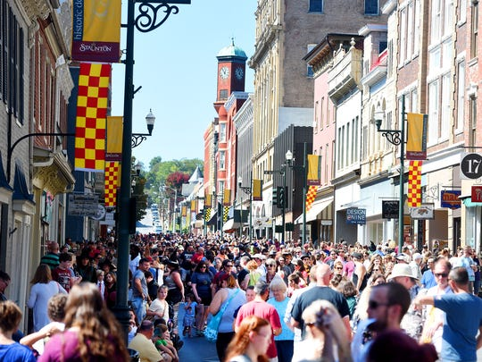 Festival-goers fill the streets during the Queen City