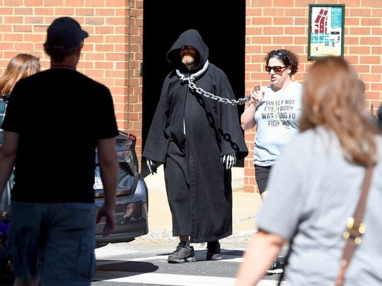 A death eater appears to be heading to Azkaban Prison as he is led across the street wearing chains during the Queen City Mischief & Magic festival in downtown Staunton on Saturday, Sept. 23, 2017. The three-day festival celebrating Harry Potter ends Sunday, Sept. 24, 2017.