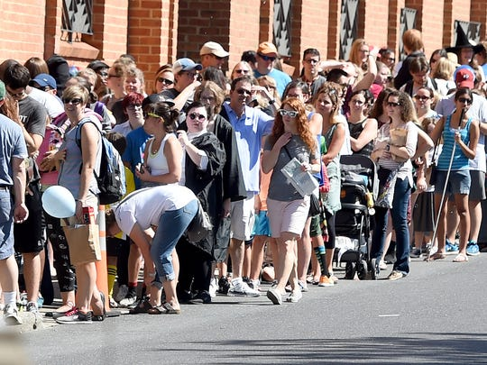 People wait to find out what there patrous charm is. They wait in a line that stretches around the block during the Queen City Mischief & Magic festival in downtown Staunton on Saturday, Sept. 23, 2017. The three-day festival celebrating Harry Potter ends Sunday, Sept. 24, 2017.