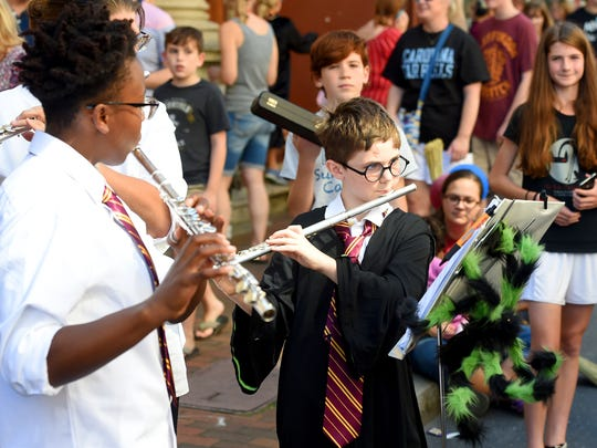 Musicians dressed for the festival perform for festival-goers from where they play on West Beverley Street during the Queen City Mischief & Magic festival in downtown Staunton on Saturday, Sept. 23, 2017. The three-day festival celebrating Harry Potter ends Sunday, Sept. 24, 2017.