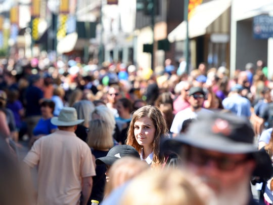 Allison White of Arlington stands out in the crowd, dressed as Hermione Granger, during the Queen City Mischief & Magic festival in downtown Staunton on Saturday, Sept. 23, 2017. The three-day festival celebrating Harry Potter ends Sunday, Sept. 24, 2017.
