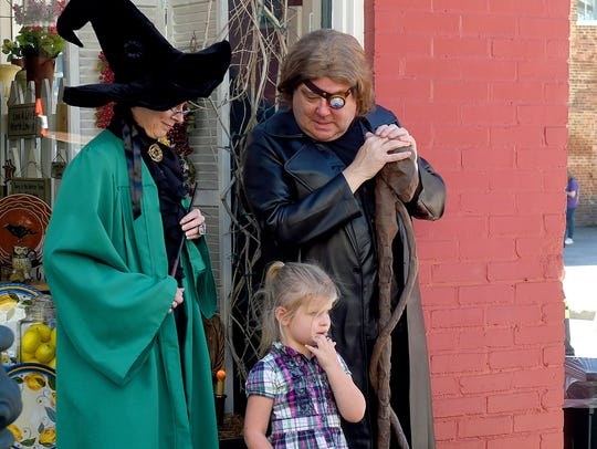 "Alastor ""Mad Eye"" Moody looks down at a young girl"