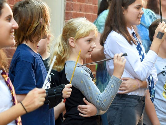 Young witches and wizards learn the art of wizard dueling at Barristers Row during the Queen City Mischief & Magic festival in downtown Staunton on Saturday, Sept. 23, 2017. The three-day festival celebrating Harry Potter ends Sunday, Sept. 24, 2017.