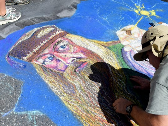 Robert Mott of Harrisonburg creates a large chalk portrait of Professor Dumbledore on the pavement of East Beverley Street during the Queen City Mischief & Magic festival in downtown Staunton on Saturday, Sept. 23, 2017. The three-day festival celebrating Harry Potter ends Sunday, Sept. 24, 2017.