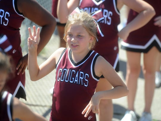 Madison Conner, 10, decided to cheer even though her