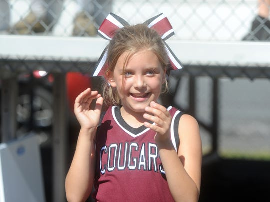 Madison Conner, 10, cheers on the sideline Saturday,