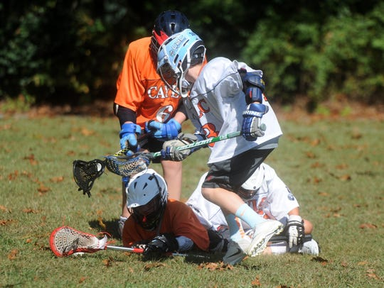 The Wolves Lacrosse competitive team practices at Guy