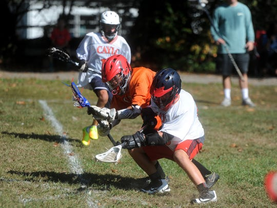 Wolves Lacrosse players battle for the ball during