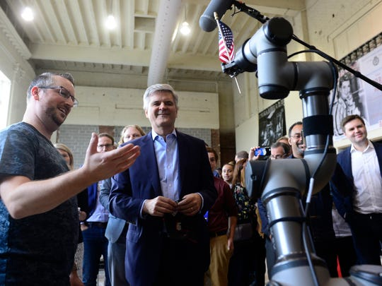 John McElligott, left the CEO of York Exponential, gives a robotics demonstration to Steve Case at the Fortress Academy in York on Tuesday, Oct. 10, 2017, during the Rise of the Rest tour. The purpose of the tour is to bring attention to startups in areas of the country that don't get a lot of attention from venture capitalists.
