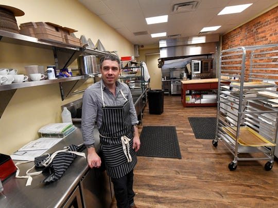 Bryan Hollar, owner and baker, stands in the kitchen at Réunion Bakery & Espresso and talks about bringing the business to reality during an interview on Tuesday, Oct. 10, 2017.