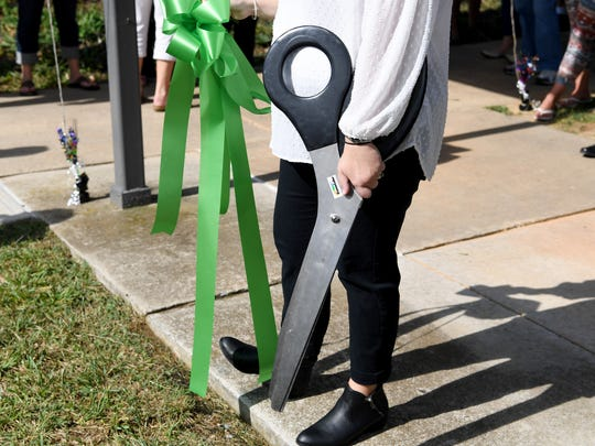 The massive scissors used for cutting ribbons at special events is held ready. A ceremony was held celebrating the completion of work converting a dorm into five independent living apartments for students on the campus of the Virginia School for the Deaf and the Blind on Wednesday, Oct. 11, 2017.