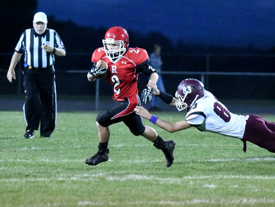 Riverheads' Devin Morris runs the football and slips