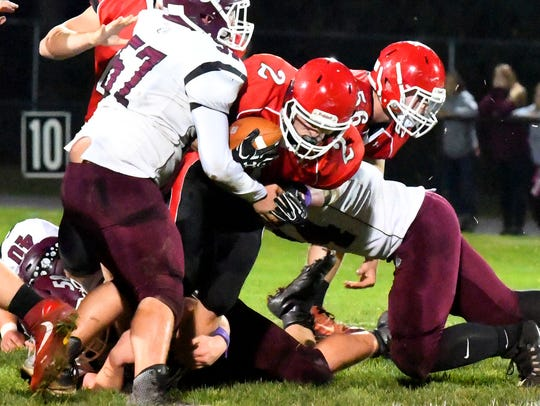 Riverheads' Devin Morris is brought down with the ball