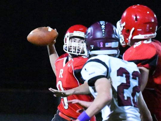 Riverheads' quarterback Tyler Smith draws back to pass the ball during a football game played in Greenville on Friday, Oct. 13, 2017.