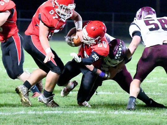 Riverheads' Jackson Shover braces himself as he is brought down with the ball after a gain of several yards during a football game played in Greenville on Friday, Oct. 13, 2017.