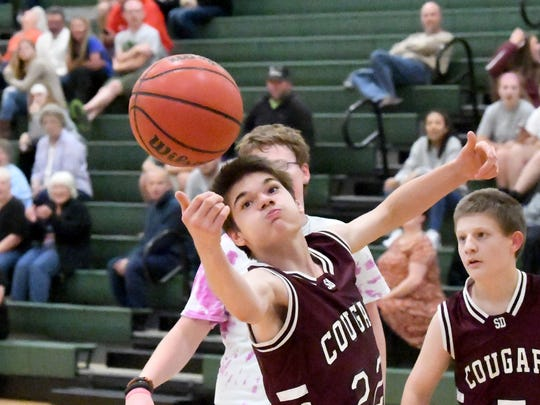 Stuarts Draft's Jeremie McKinney reaches for the rebound during one of two Unified Basketball finale games played in Fishersville on Monday, Oct. 16, 2017.