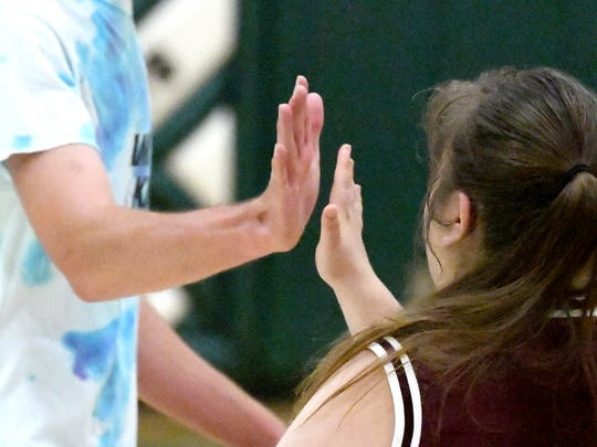 """Players from Wilson Memorial and Stuarts Draft slap hands and tell each other """"good game"""" at the end of one of two Unified Basketball finale games played in Fishersville on Monday, Oct. 16, 2017."""