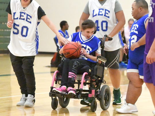 R.E. Lee's Taylor Spradlin takes the ball downcourt during one of two Unified Basketball finale games played in Fishersville on Monday, Oct. 16, 2017.