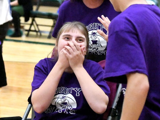 Waynesboro's Ashlen Lowery brings hands to mouth as she scores a basket during one of two Unified Basketball finale games played in Fishersville on Monday, Oct. 16, 2017.