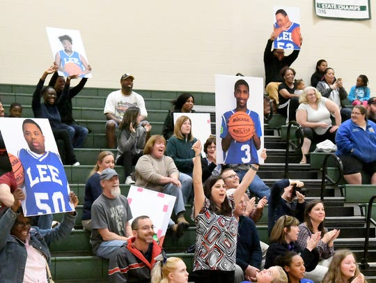 Fans for R.E. Lee cheer during one of two Unified Basketball