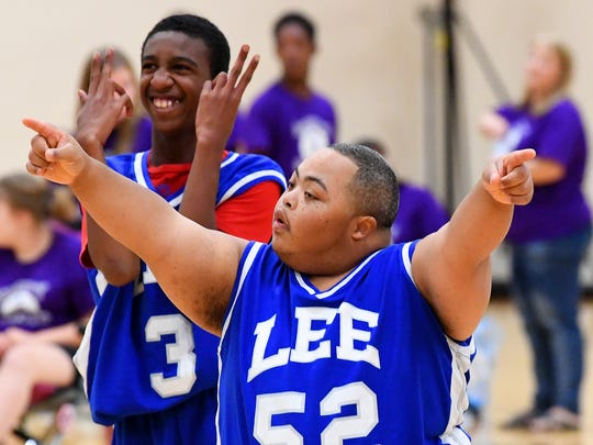 R.E. Lee's Caleb Harden celebrates another basket for his team during one of two Unified Basketball finale games played in Fishersville on Monday, Oct. 16, 2017.
