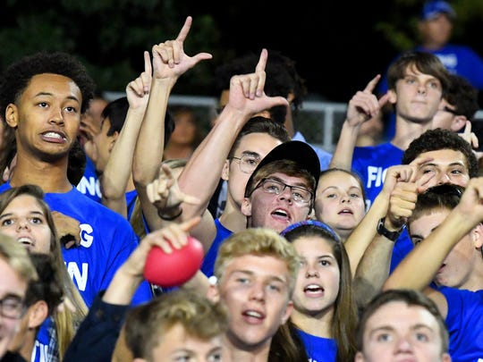 Robert E. Lee fans sing the fight song after their team scores a touchdown during a football game played in Staunton on Friday, Oct. 20, 2017.