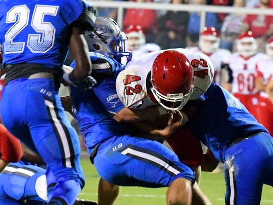 Riverheads'. Moose Lee is held by the Robert E. Lee defense during a football game played in Staunton on Friday, Oct. 20, 2017.