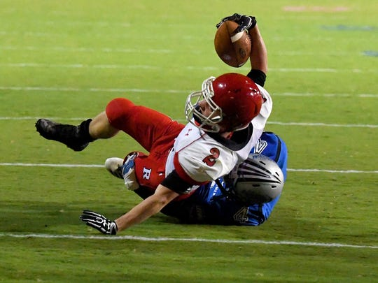 Riverheads' Devin Morris has the ball as he is dragged down by Robert E. Lee's Ta'Corrious Strother during a football game played in Staunton on Friday, Oct. 20, 2017.