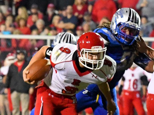 Riverheads' Tyler Smith has the football and looks