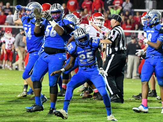 Robert E. Lee's Dylan Culpen, Isaih Edmonds and Devin Williams celebrate after they hold Riverheads to keep them from scoring on the drive, despite being in the red zone, during a football game played in Staunton on Friday, Oct. 20, 2017.