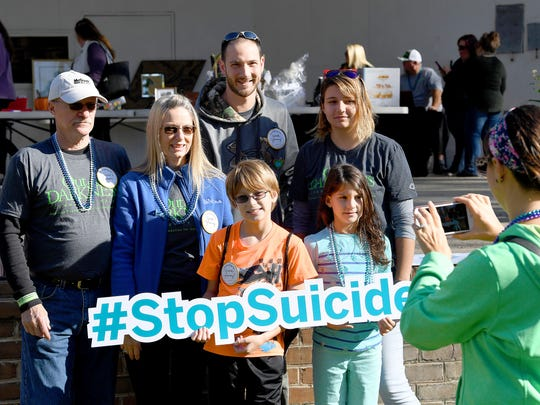 One of the many walking teams stand together to have their photo taken with the #StopSuicide sign at the event. The third annual Greater Augusta Out of the Darkness Walk was held at Gypsy Hill Park on Saturday, Oct. 21, 2017. The event brought together people affected by suicide and promoted awareness to suicide prevention.