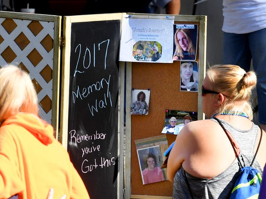 A memory wall offers a place for participants to remember loved ones lost to suicide. The third annual Greater Augusta Out of the Darkness Walk was held at Gypsy Hill Park on Saturday, Oct. 21, 2017. The event brought together people affected by suicide and promoted awareness to suicide prevention.