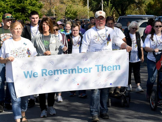 """Ginger and Mark Ham of Staunton hold the """"We Remember"""