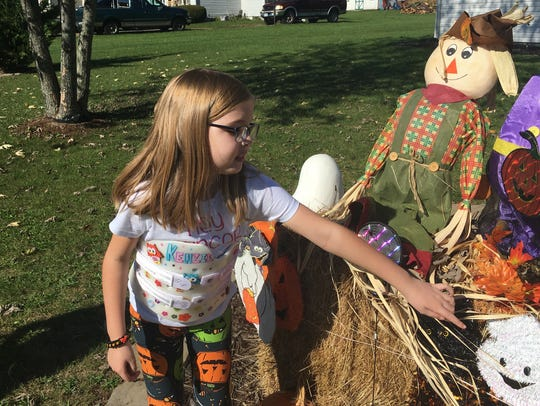 McKenzie Woods, 8, points to a ghost in the Halloween