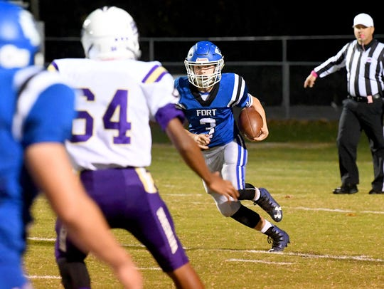 Fort Defiance's Cole Sligh runs the football at the