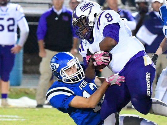 Waynesboro's Alijah Braxton protects the football as