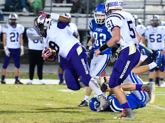 Waynesboro's Alijah Braxton attempts to leap overtop Fort Defiance's Aaron Wright, but Wright grabs him and will pull him down for the stop during a game played in Fort Defiance on Friday, Oct. 27, 2017.