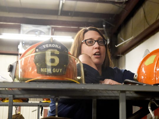 Waiting on potential emergency calls, volunteer EMT Anne Lynch hangs out and socializes with other members of Verona Volunteer Fire Company at the company's firehouse in Verona on Sept. 11, 2017.