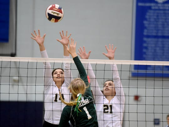 Delone Catholic's Molly Raville, left, and Kristin
